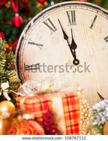 Old wooden clock and Christmas decorations. New year concept