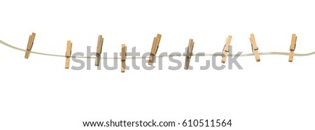 Old wooden clothespins on a rope isolated on  white background