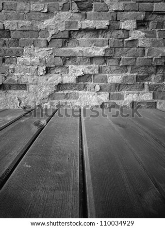 Old wooden  dark stage and an old brick wall, background