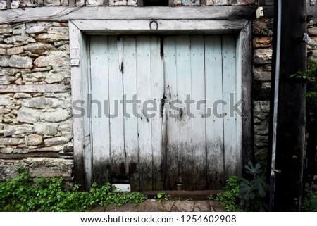 old wooden door #1254602908
