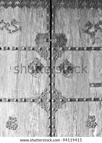 Old wooden door in chinese style of famous temple.