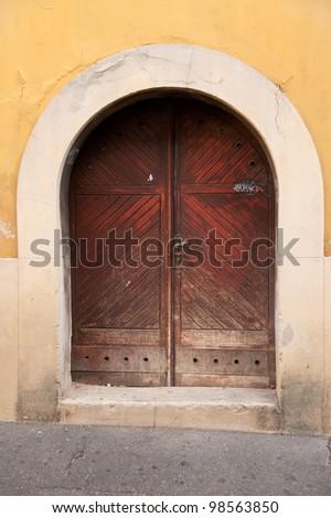 Old wooden door in historical part of Zagreb, Croatia