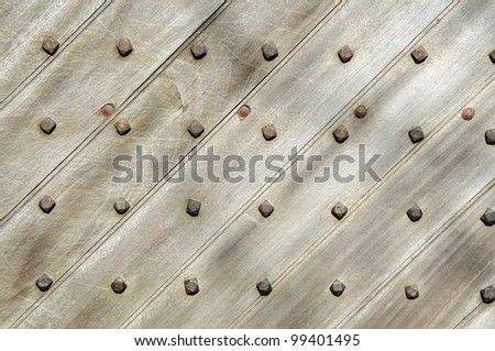 old wooden door in medieval castle pattern