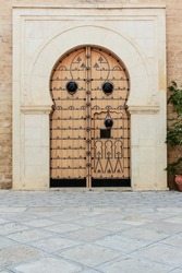 Old wooden door in Ribat old fortress Sousse. Tunisia