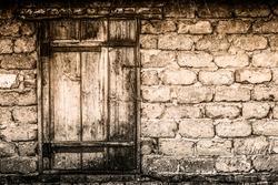 Old wooden door in rural barn closeup.