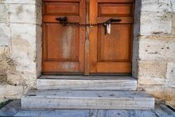 old wooden door locked by chain