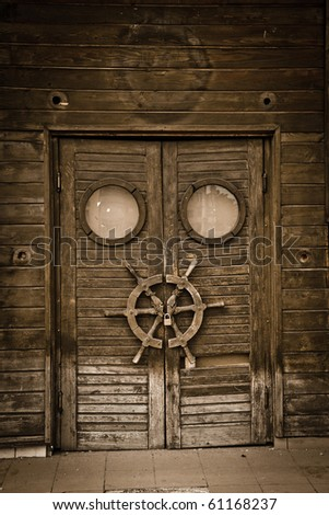 Old wooden door on an abandoned boat, vintage style.