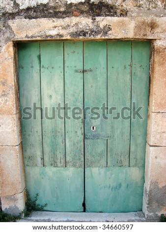 Old wooden door on Hvar old town, Croatia - stock photo