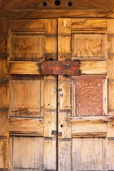 Old wooden door to mausoleum at Denver's historic Riverside Cemetery