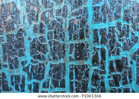 old wooden door with a blue and crack