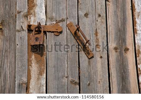 old wooden door with lock and handle