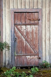 Old wooden door with stone step