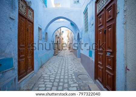 old wooden doors and blue walls on the street in old town in Tunisia #797322040