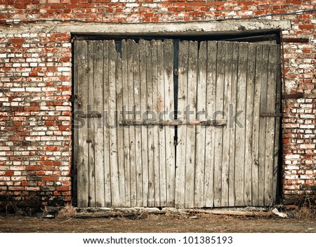 old wooden doors at brick building