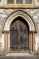 Old wooden doors at the entrance to an old english church