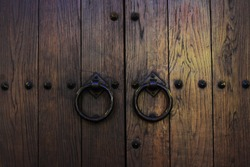 Old wooden doors with rings