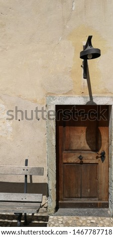 Old wooden doorway and weathered wall #1467787718