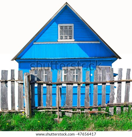 old wooden fence  against blue building