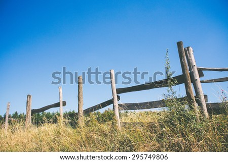 Old wooden fence and blue sky, country living #295749806