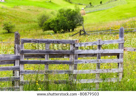 Old wooden fence and gate at a farm in the mountains