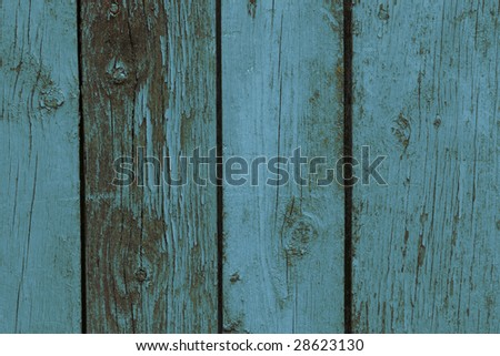Old wooden fence. Blue