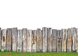 old wooden fence in garden with grass