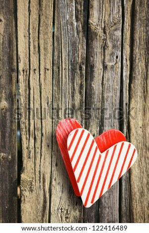Old wooden fence with two hearts
