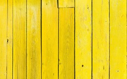 old wooden fence with yellow paint