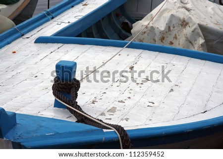 Old wooden fishing boat. Small fishing boat.