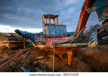 Old Wooden fishing Boat Wreck at sunrise, Portugal, HDR image