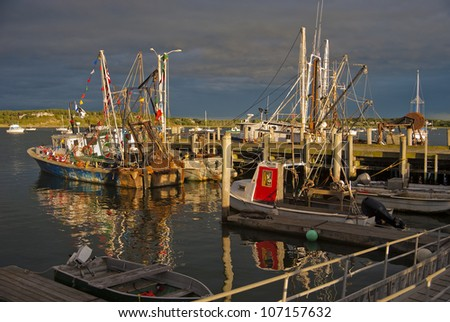 Old wooden fishing boats in harbor before a storm