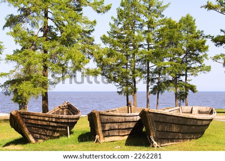 old wooden fishing boats on the Baikal lakeside