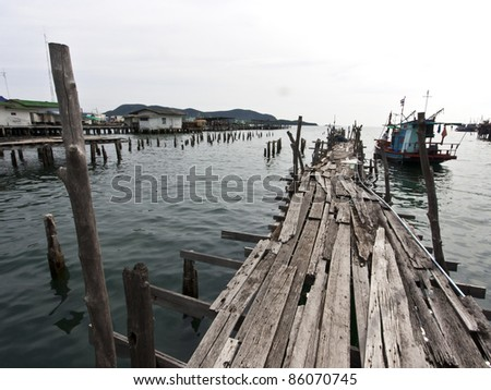 Old wooden fishing bridge to the sea