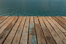 Old wooden floor and lake