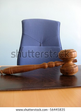 Old wooden gavel ,blue chair and court desk - stock photo