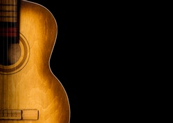 Old wooden guitar isolated. Music instruments close up