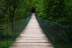 Old wooden hanging bridge upon the mountain leading from the Lazar cave in Lazarev canyon, Serbia