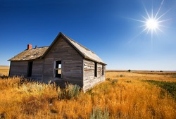 Old wooden home abandoned in the grasslands