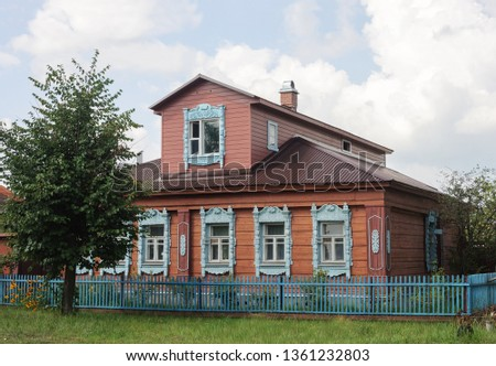 Old wooden house with mezzanine and decorated windows in russian town Kirzhach, Vladimir region