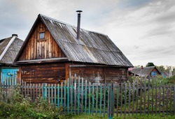 Old wooden house . Wooden fence.