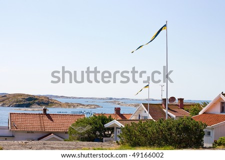 Old wooden houses and sea archipelago in the horizon
