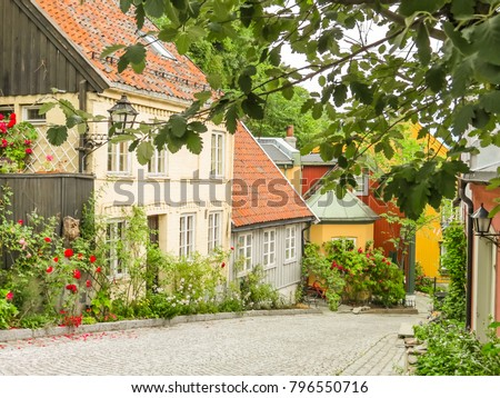 Old wooden houses in the historic center of Oslo. Damstredet, residential area of Oslo with well-preserved wooden houses from the late 1700s and the 1800s. Landmark of Oslo, Norway capital