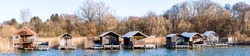 old wooden hut at a lake