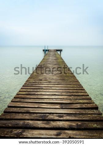 old wooden jetty at Lake Garda, Italy