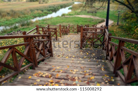 Old wooden ladder on the river