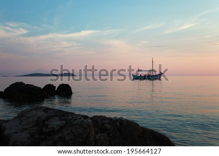 Old wooden little boat wait for the sunset in Greece / Boat on the sunset
