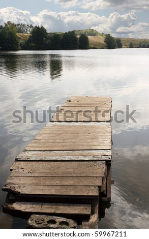 Old wooden mooring. Vertical photo