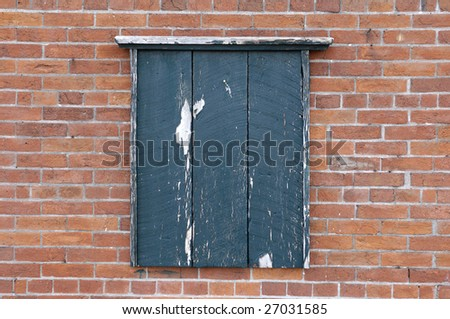 Old wooden notice board on a brick wall