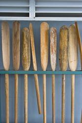 Old wooden oars in storeroom.