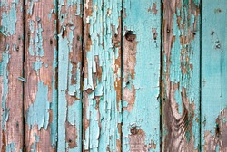 Old wooden painted light blue rustic fence, paint peeling background